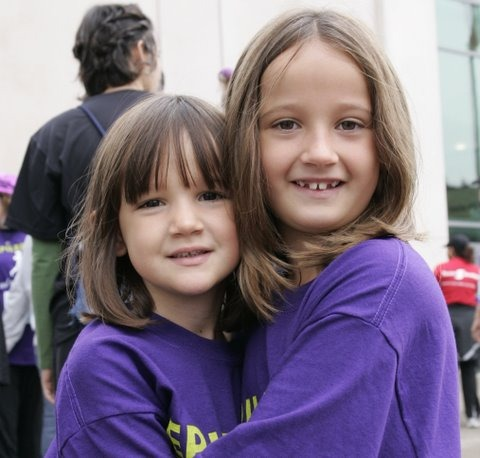 Two girls in purple t-shirts