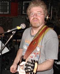 Jim Armstrong playing a guitar
