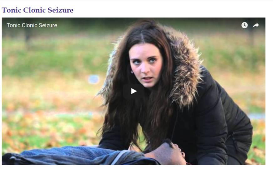 Video screen grab of a woman next to a man having a tonic clonic seizure.
