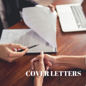 Hands of two people on a desk with a cover letter