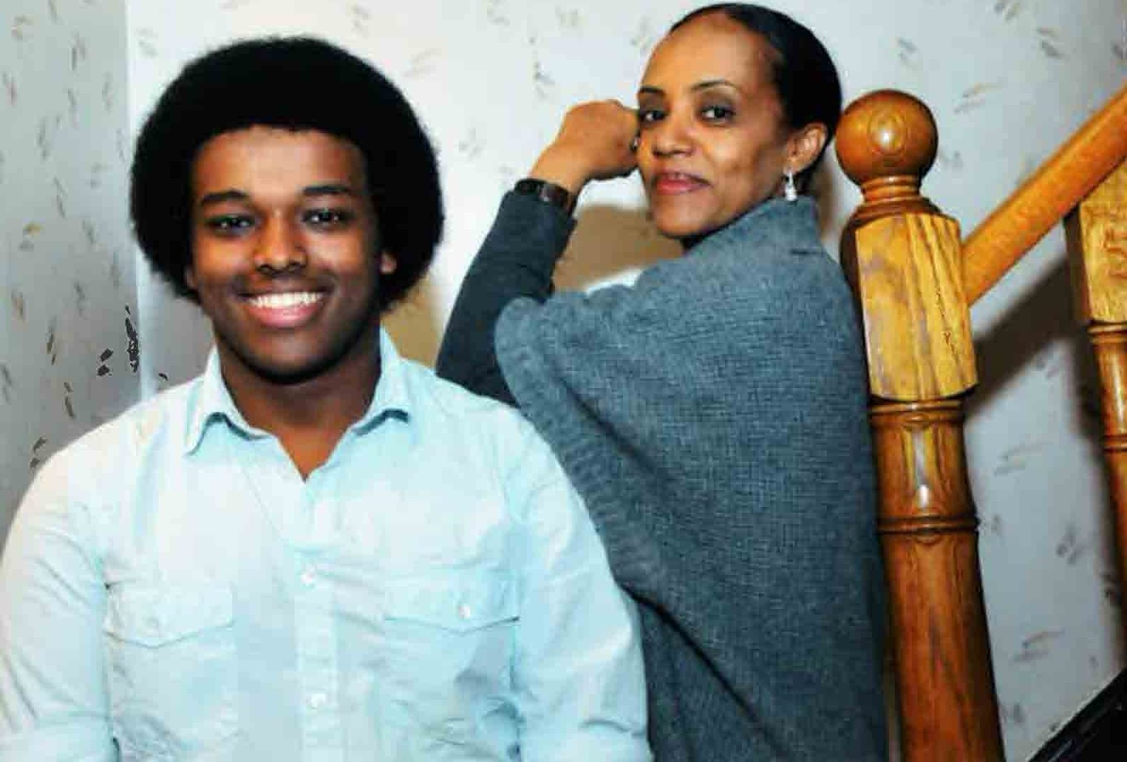 Anna and her Son Nebyu posing for a photo together, standing on a staircase